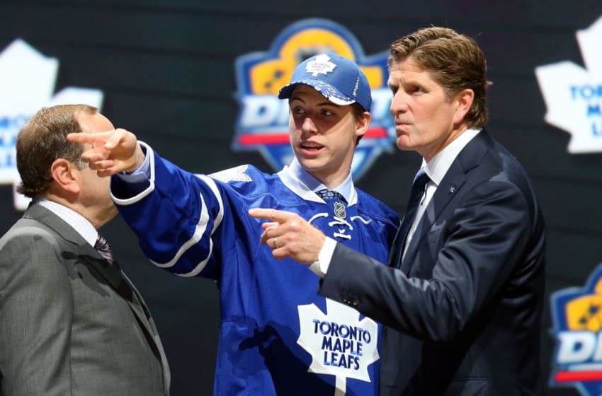SUNRISE, FL - JUNE 26: Head coach Mike Babcock of the Toronto Maple Leafs talks with Mitchell Marner after being selected fourth overall by the Toronto Maple Leafs in the first round of the 2015 NHL Draft at BB&T Center on June 26, 2015 in Sunrise, Florida. (Photo by Bruce Bennett/Getty Images)