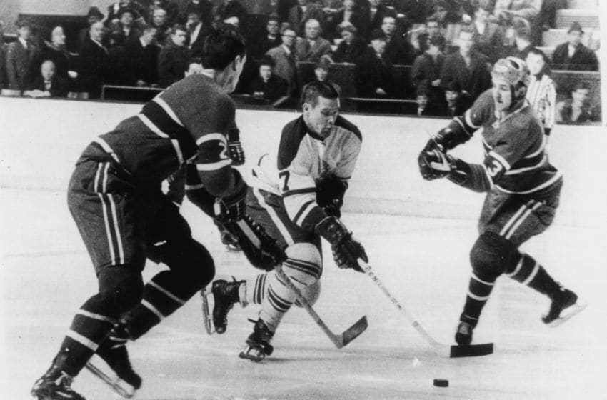 Canadian hockey player Tim Horton (center) of the Toronto Maple Leafs skates between Jacques Laperriere (#2) and Jean Claude Trembly (#3), both of the Montreal Canadiens, during a game in Montreal, Quebec, Canada, February 1, 1967. (Photo by Bruce Bennett Studios via Getty Images Studios/Getty Images)