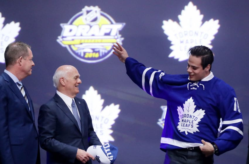 BUFFALO, NY - JUNE 24: Auston Matthews celebrates onstage with Toronto Maple Leafs General Manager Lou Lamoriello after being selected first overall during round one of the 2016 NHL Draft on June 24, 2016 in Buffalo, New York. (Photo by Bruce Bennett/Getty Images)