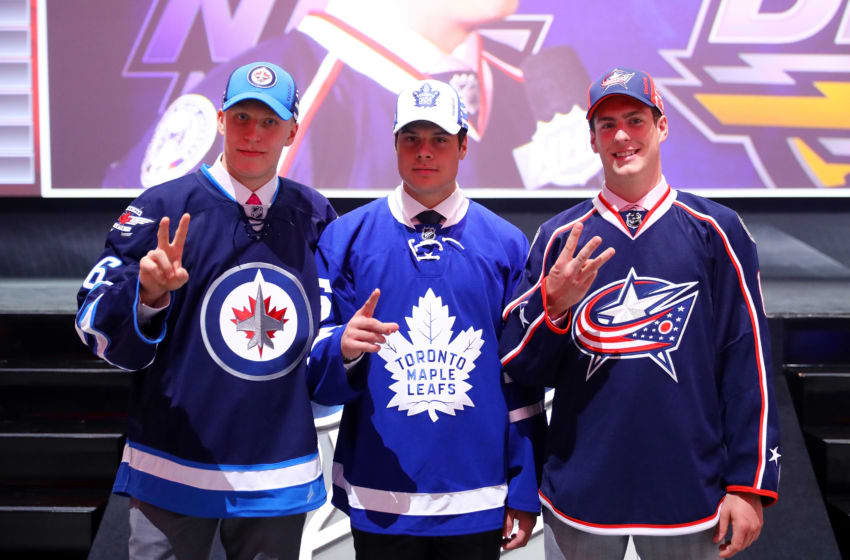 BUFFALO, NY - JUNE 24: Winnepegs Jets second overall pick Patrik Laine, Toronto Maple Leafs first overall pick Auston Matthews and Columbus Blue Jackets third overall pick Pierre-Luc Dubois celebrate during round one of the 2016 NHL Draft on June 24, 2016 in Buffalo, New York. (Photo by Bruce Bennett/Getty Images)