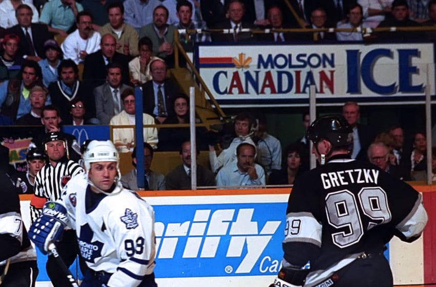 TORONTO, ON - MAY 17: Wayne Gretzky #99 of the Los Angeles Kings skates by Doug Gilmour #93 of the Toronto Maple Leafs during NHL semi final series playoff game action on May 17, 1993 at Maple Leaf Gardens in Toronto, Ontario Canada. (Photo by Graig Abel/Getty Images)