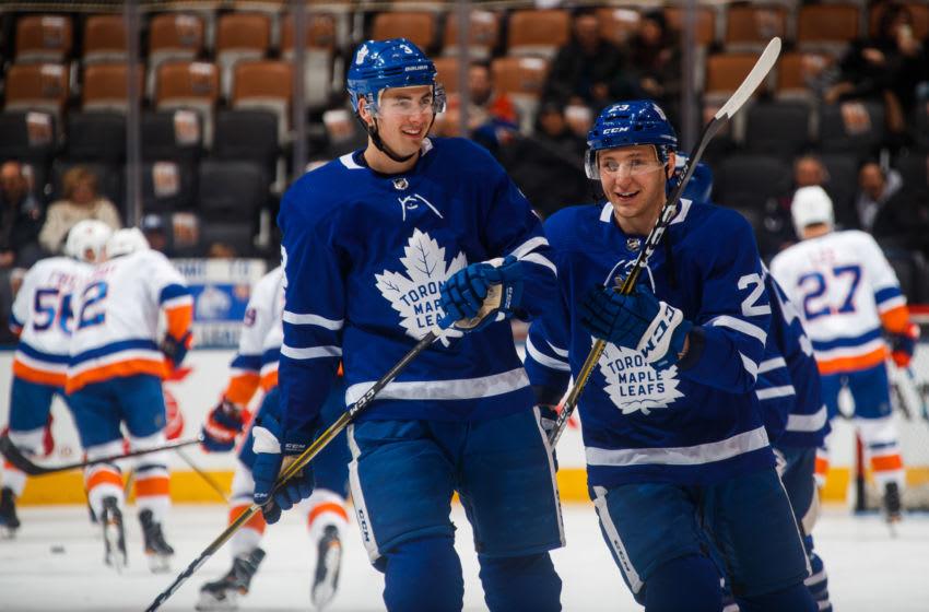 Toronto Maple Leafs - Justin Holl #3 and Travis Dermott #23 (Photo by Mark Blinch/NHLI via Getty Images)