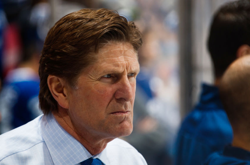 TORONTO, ON - APRIL 19: Mike Babcock of the Toronto Maple Leafs watches warm up before Game Four of the Eastern Conference First Round against the Boston Bruins during the 2018 NHL Stanley Cup Playoffs at the Air Canada Centre on April 19, 2018 in Toronto, Ontario, Canada. (Photo by Mark Blinch/NHLI via Getty Images)