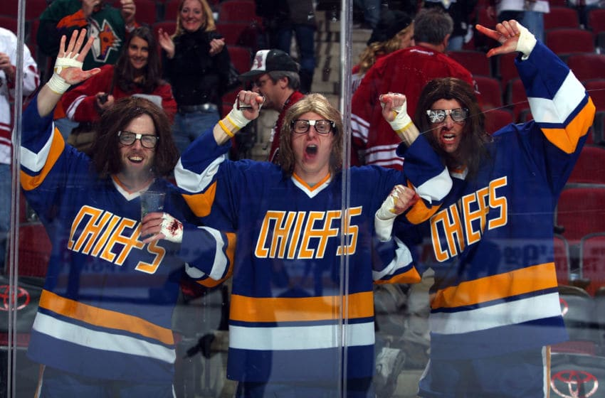 GLENDALE, AZ - JANUARY 14: Fans dressed as the Hanson Brothers cheer along the boards following the NHL game between the New Jersey Devils and the Phoenix Coyotes at Jobing.com Arena on January 14, 2010 in Glendale, Arizona. The Coyotes defeated the Devils 4-3. (Photo by Christian Petersen/Getty Images)