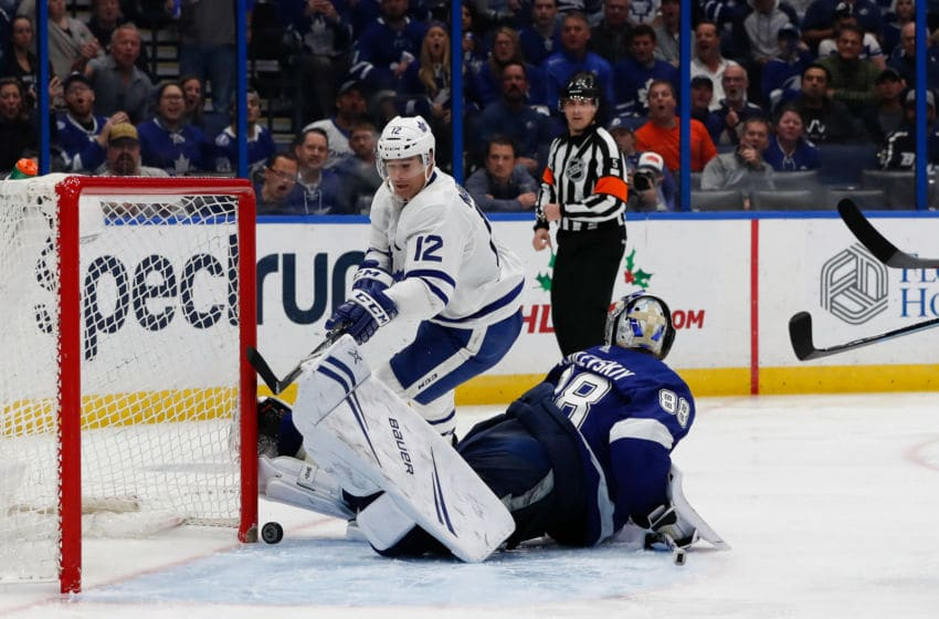 TAMPA, FL - DECEMBER 13: Goalie Andrei Vasilevskiy #88 of the Tampa Bay Lightning makes a save against Patrick Marleau #12 of the Toronto Maple Leafs during the third period at Amalie Arena on December 13, 2018 in Tampa, Florida. (Photo by Mark LoMoglio/NHLI via Getty Images)