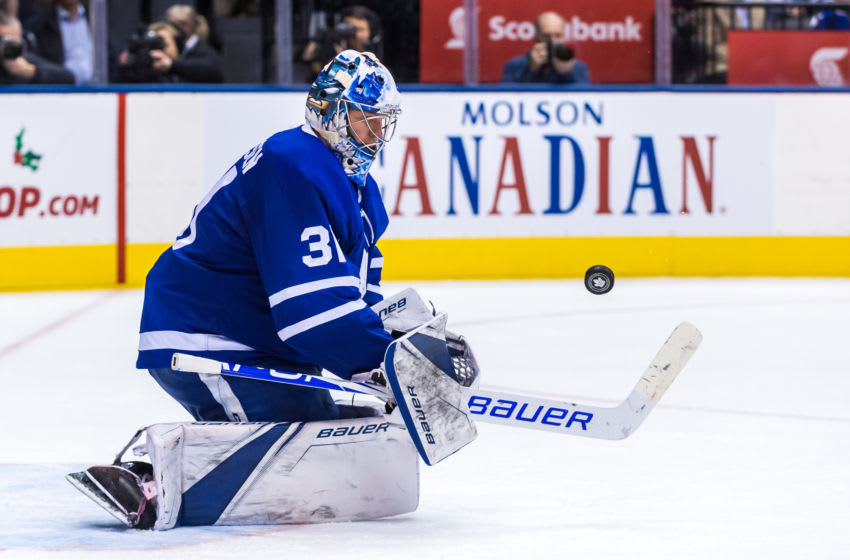 TORONTO, ON - NOVEMBER 26: Frederik Andersen #31 of the Toronto Maple Leafs stops the puck against the Boston Bruins during the third period at the Scotiabank Arena on November 26, 2018 in Toronto, Ontario, Canada. (Photo by Kevin Sousa/NHLI via Getty Images)
