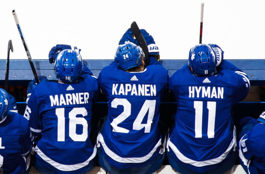 TORONTO, ON - MARCH 25: Mitch Marner #16, Kasperi Kapanen #24, and Zach Hyman #11 of the Toronto Maple Leafs sit on the bench while playing the Florida Panthers during the first period at the Scotiabank Arena on March 25, 2019 in Toronto, Ontario, Canada. (Photo by Mark Blinch/NHLI via Getty Images)