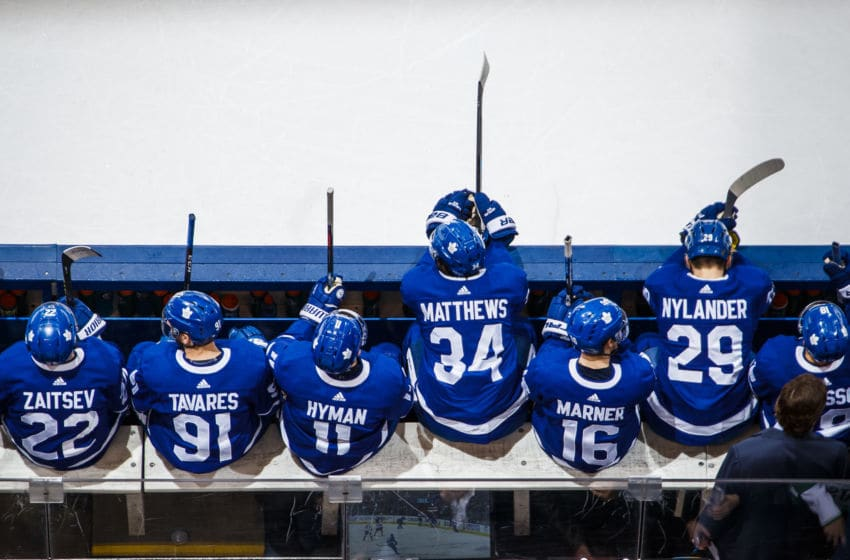 TORONTO, ON - MARCH 25: Nikita Zaitsev #22, John Tavares #91, Zach Hyman #11, Auston Matthews #34, Mitch Marner #16, William Nylander #29, and Andreas Johnsson #18 of the Toronto Maple Leafs sit on the bench while playing the Florida Panthers during the first period at the Scotiabank Arena on March 25, 2019 in Toronto, Ontario, Canada. (Photo by Mark Blinch/NHLI via Getty Images)