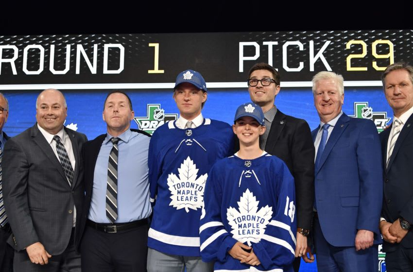 Jun 22, 2018; Dallas, TX, USA; Rasmus Sandin poses for a photo with team representatives after being selected as the number twenty-nine overall pick to the Toronto Maple Leafs in the first round of the 2018 NHL Draft at American Airlines Center. Mandatory Credit: Jerome Miron-USA TODAY Sports