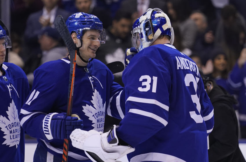 Feb 20, 2020; Toronto, Ontario, CAN; Toronto Maple Leafs forward Zach Hyman (11) and Toronto Maple Leafs goaltender Frederik Andersen (31) celebrate a win over the Pittsburgh Penguins at Scotiabank Arena. Mandatory Credit: John E. Sokolowski-USA TODAY Sports