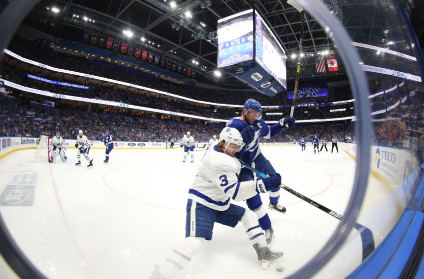 Feb 25, 2020; Tampa, Florida, USA; Tampa Bay Lightning center Steven Stamkos (91) defends Toronto Maple Leafs defenseman Justin Holl (3) on the boards during the first period at Amalie Arena. Mandatory Credit: Kim Klement-USA TODAY Sports