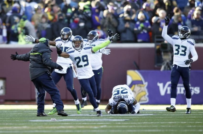 Jan 10, 2016; Minneapolis, MN, USA; Seattle Seahawks players including Earl Thomas (29) and Richard Sherman (25) and Kelcie McCray (33) celebrate after Minnesota Vikings kicker Blair Walsh (not pictured) missed a field goal in the fourth quarter in a NFC Wild Card playoff football game at TCF Bank Stadium. Mandatory Credit: Bruce Kluckhohn-USA TODAY Sports