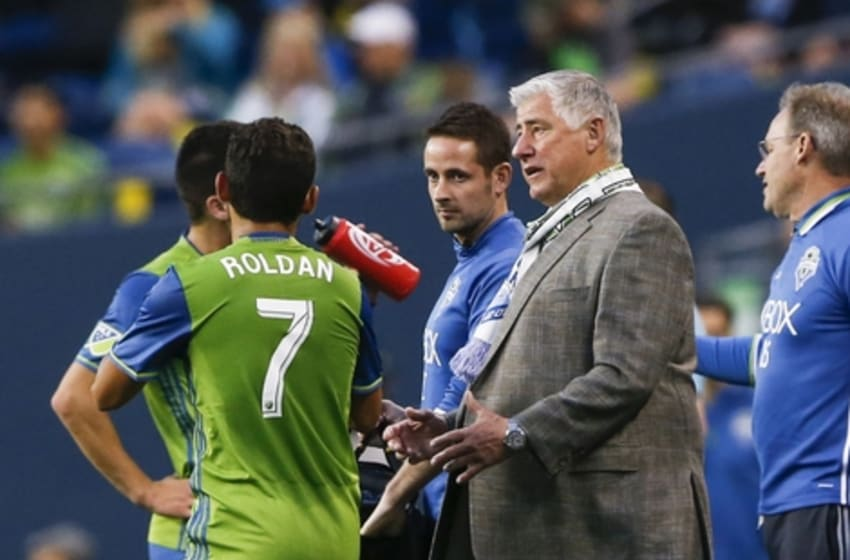 Jul 13, 2016; Seattle, WA, USA; Seattle Sounders FC head coach Sigi Schmid speaks with his players during a break in play for an injury in the second half against the FC Dallas at CenturyLink Field. Seattle defeated Dallas 5-0. Mandatory Credit: Joe Nicholson-USA TODAY Sports