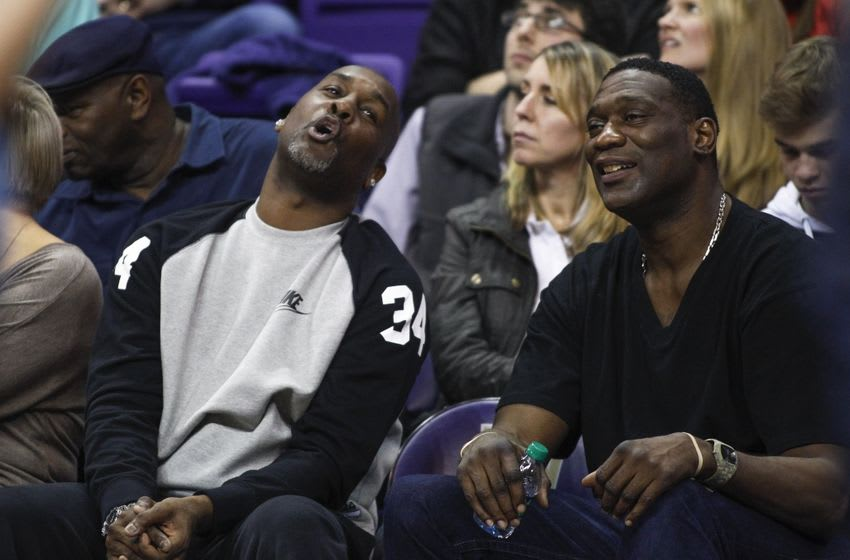 Jan 15, 2015; Seattle, WA, USA; Seattle Supersonics former guard Gary Payton and former forward Shawn Kemp react to a play during the the second half of a game in which their sons Oregon State Beavers guard Gary Payton II (1) and Washington Huskies forward Shawn Kemp, Jr. (40) play at Alaska Airlines Arena. Mandatory Credit: Joe Nicholson-USA TODAY Sports