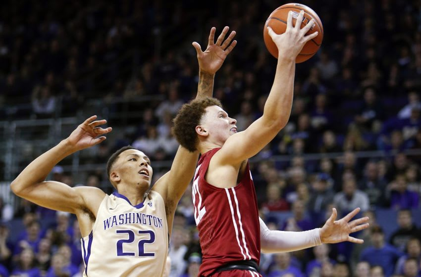 Jan 1, 2017; Seattle, WA, USA; Washington State Cougars guard Malachi Flynn (22, right) scores a basket against Washington Huskies forward Dominic Green (22) during the second half at Alaska Airlines Arena at Hec Edmundson Pavilion. Washington State defeated Washington, 79-74. Mandatory Credit: Jennifer Buchanan-USA TODAY Sports