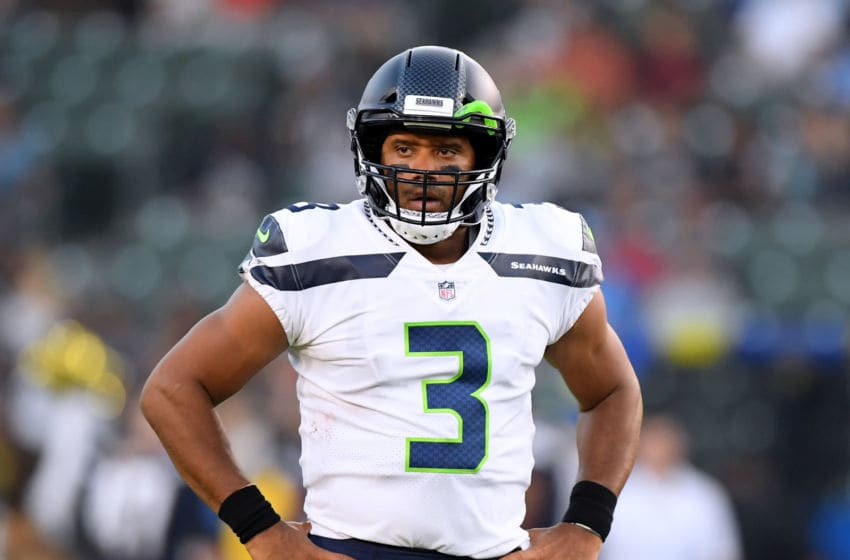 CARSON, CA - AUGUST 18: Russell Wilson #3 of the Seattle Seahawks reacts as a touchdown is called back after a Seahawk penalty during the first quarter of a presseason game against the Los Angeles Chargers at StubHub Center on August 18, 2018 in Carson, California. (Photo by Harry How/Getty Images)