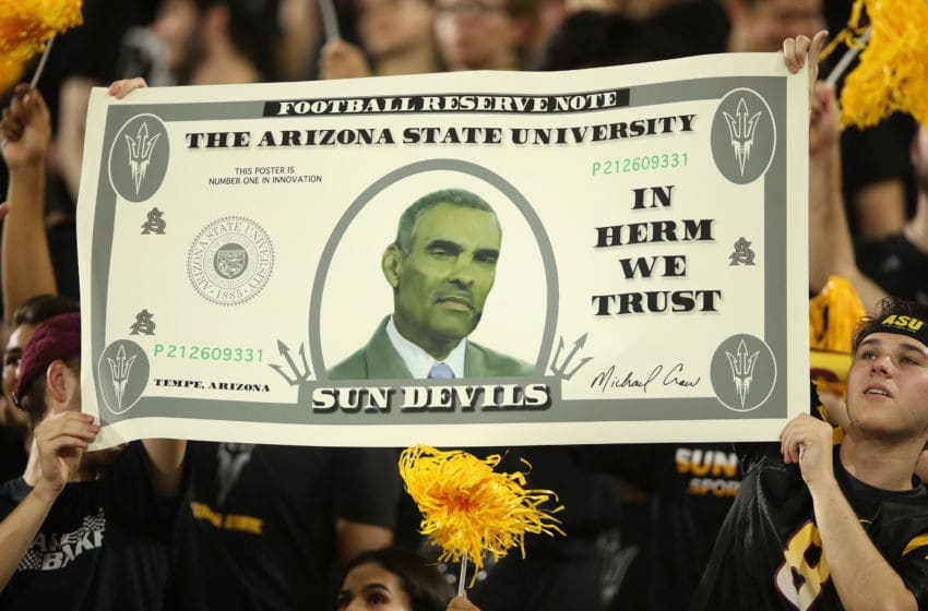 TEMPE, AZ - SEPTEMBER 08: Head coach Herm Edwards of the Arizona State Sun Devils is displayed on a 'money sign' from fans during the second half of the college football game against the Michigan State Spartans at Sun Devil Stadium on September 8, 2018 in Tempe, Arizona. The Sun Devils defeated the Spartans 16-13. (Photo by Christian Petersen/Getty Images)
