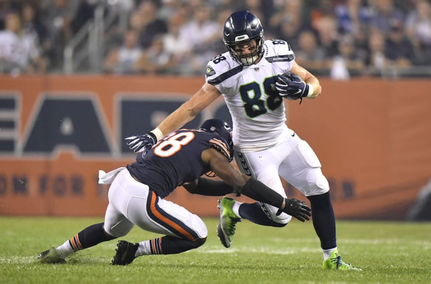 Adrian Amos, Chicago Bears. Will Dissly, Seattle Seahawks. (Photo by Quinn Harris/Getty Images)