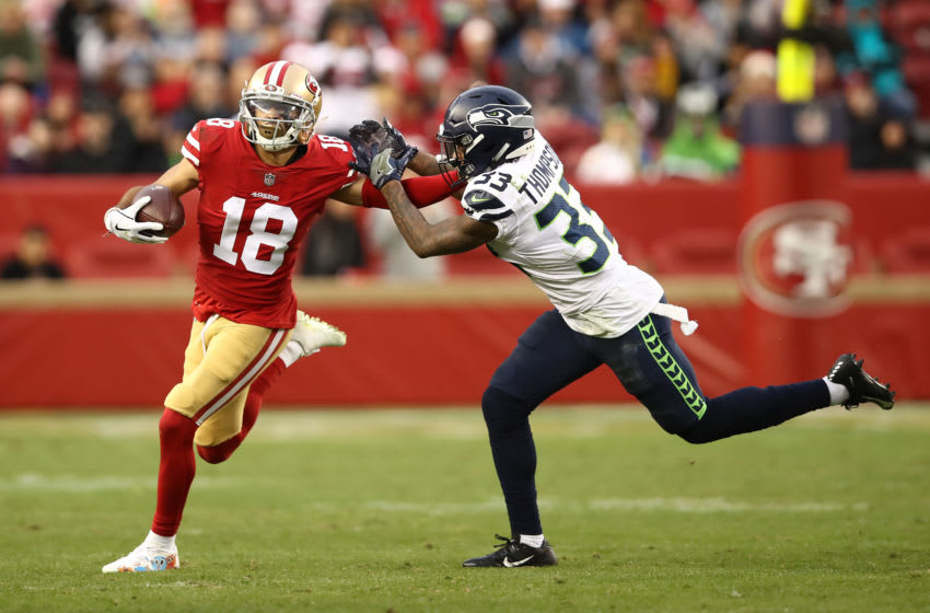 Dante Pettis, San Francisco 49ers. Tedric Thompson, Seattle Seahawks. (Photo by Ezra Shaw/Getty Images)