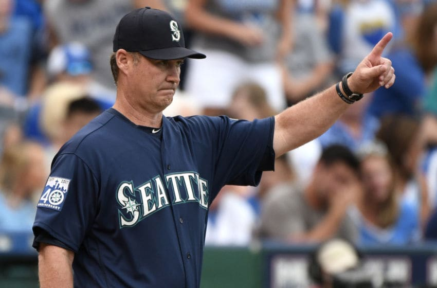 KANSAS CITY, MO: Scott Servais #9 manager of the Seattle Mariners signals for a pitching change as he heads to the mound in the fifth inning against the Kansas City Royals in game one of a doubleheader at Kauffman Stadium on August 6, 2017. (Photo by Ed Zurga/Getty Images)