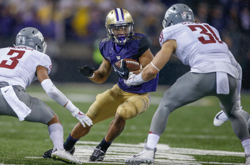 Myles Gaskin, Washington Huskies. Darrien Molton, Washington State Cougars. Apple Cup. (Photo by Otto Greule Jr/Getty Images)