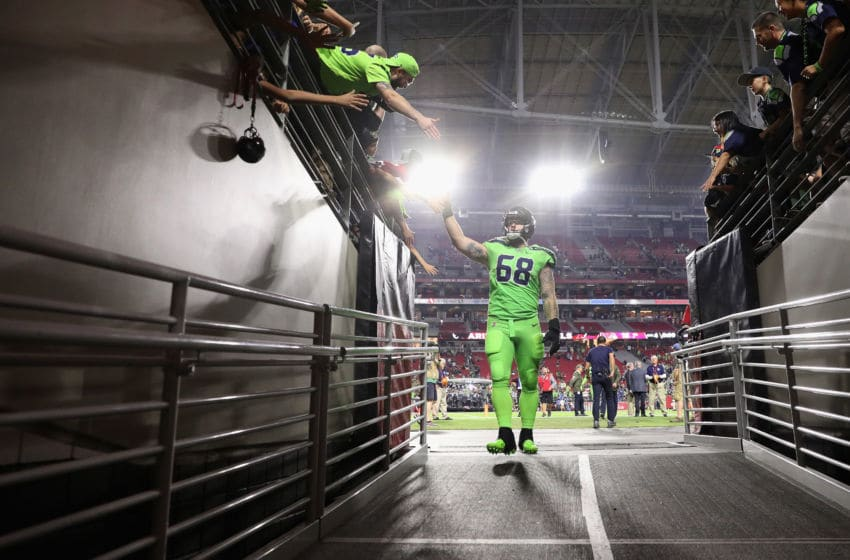 GLENDALE, AZ - NOVEMBER 09: Center Justin Britt #68 of the Seattle Seahawks waves to fans as he leaves the field following the NFL game against the Arizona Cardinals at the University of Phoenix Stadium on November 9, 2017 in Glendale, Arizona. The Seahawks defeated the Cardinals 22-16. (Photo by Christian Petersen/Getty Images)