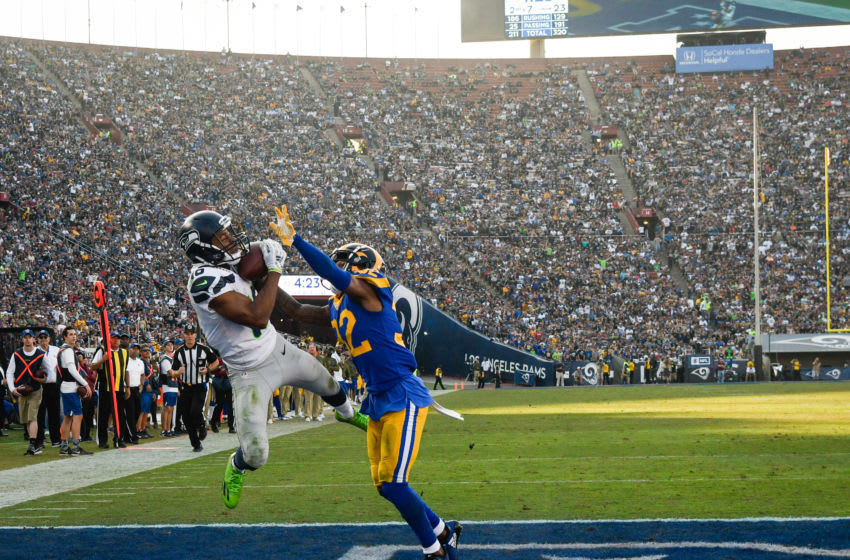 LOS ANGELES, CA - NOVEMBER 11: Wide receiver Tyler Lockett #16 of the Seattle Seahawks makes a catch to score a touchdown in front of cornerback Troy Hill #32 of the Los Angeles Rams in the third quarter at Los Angeles Memorial Coliseum on November 11, 2018 in Los Angeles, California. (Photo by John McCoy/Getty Images)