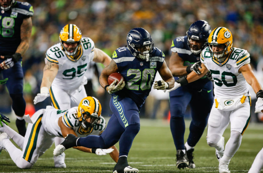 SEATTLE, WA - NOVEMBER 15: Rashaad Penny #20 of the Seattle Seahawks runs the ball passed Blake Martinez #50 of the Green Bay Packers in the first half at CenturyLink Field on November 15, 2018 in Seattle, Washington. (Photo by Otto Greule Jr/Getty Images)