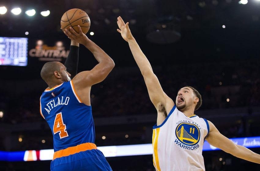 Mar 16, 2016; Oakland, CA, USA; New York Knicks guard Arron Afflalo (4) shoots against Golden State Warriors guard Klay Thompson (11) during the second quarter at Oracle Arena. Mandatory Credit: Kelley L Cox-USA TODAY Sports