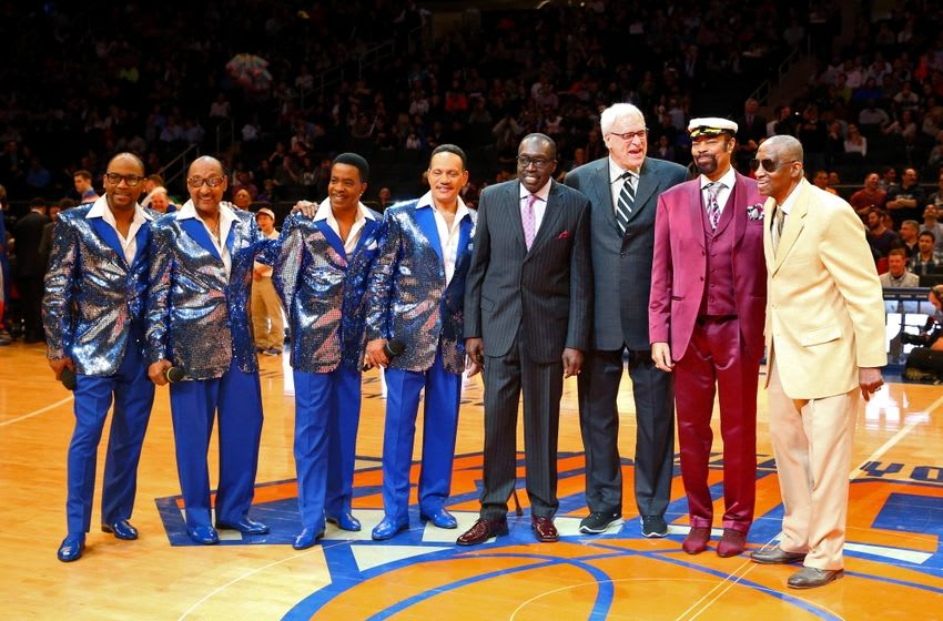 Mar 27, 2015; New York, NY, USA; Vocal group the Four Tops with former NBA player Earl Monroe (purple tie) and New York Knicks president Phil Jackson and Walt Frazier and former NBA player Dick Barnett (right) acknowledge Walt Frazier for his 70th birthday during the game between the New York Knicks and the Boston Celtics at Madison Square Garden. Mandatory Credit: Anthony Gruppuso-USA TODAY Sports