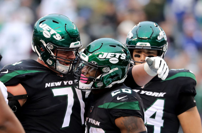 Le'Veon Bell, Alex Lewis, New York Jets. (Photo by Elsa/Getty Images)