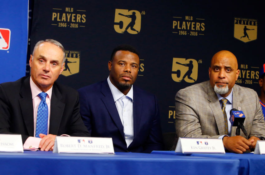 Commissioner of Baseball Robert D. Manfred Jr., Ken Griffey jr.,MLBPA Executive Director Tony Clark. (Photo by Jim McIsaac/Getty Images)