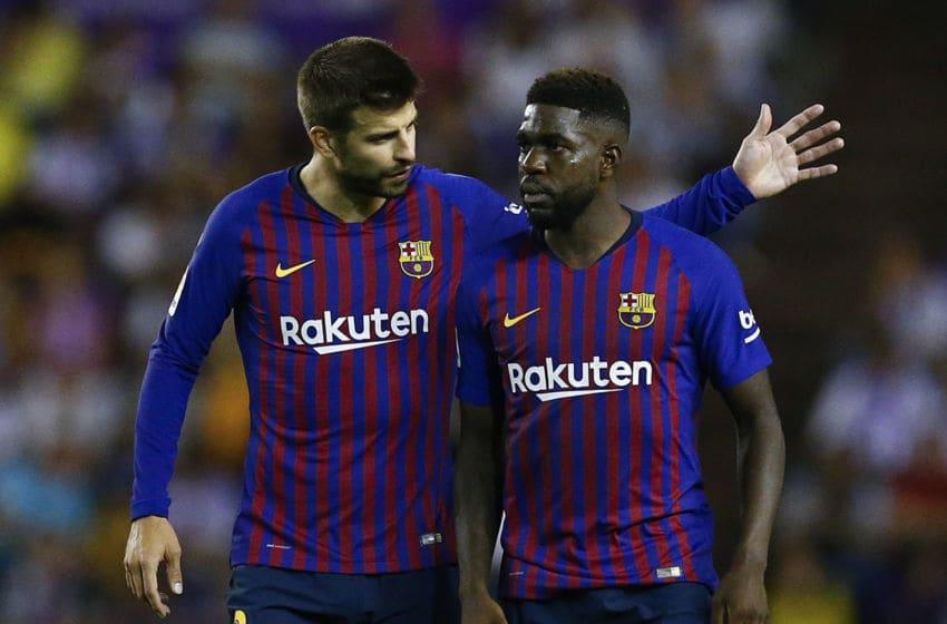 Barcelona's Spanish defender Gerard Pique (L) talks to Barcelona's French defender Samuel Umtiti. (Photo credit BENJAMIN CREMEL/AFP/Getty Images)