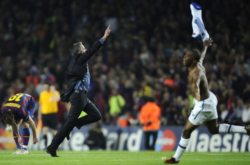 Inter Milan's Portuguese coach Jose Mourinho (C) and Cameroonian forward Samuel Eto'o (R) celebrate after winning the UEFA Champions League semi-final second leg football match Barcelona vs Inter Milan on April 28, 2010 at the Camp Nou stadium in Barcelona. Milan reached the Champions League final beating Barcelona 3-2 on aggregate in their semi-final despite losing the second leg 1-0. AFP PHOTO / FILIPPO MONTEFORTE (Photo credit should read FILIPPO MONTEFORTE/AFP via Getty Images)