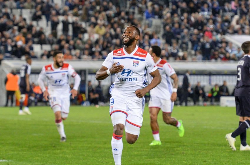 Lyon's French forward Moussa Dembele (C) celebrates after scoring a goal during the French L1 football match between Bordeaux (FCGB) and Lyon (OL) on April 26, 2019 at the Matmut Atlantique stadium in Bordeaux, southwestern France. (Photo by NICOLAS TUCAT / AFP) (Photo credit should read NICOLAS TUCAT/AFP via Getty Images)