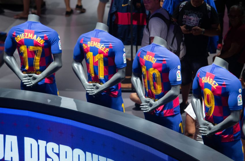 The new Barcelona FC home kit jerseys bearing the names of Barcelona's French forward Antoine Griezmann, Barcelona's French forward Ousmane Dembele, Barcelona's Argentinian forward Lionel Messi and Barcelona's Uruguayan forward Luis Suarez are displayed at the Spanish club's official store in Barcelona on August 2, 2019. (Photo by Josep LAGO / AFP) (Photo credit should read JOSEP LAGO/AFP/Getty Images)