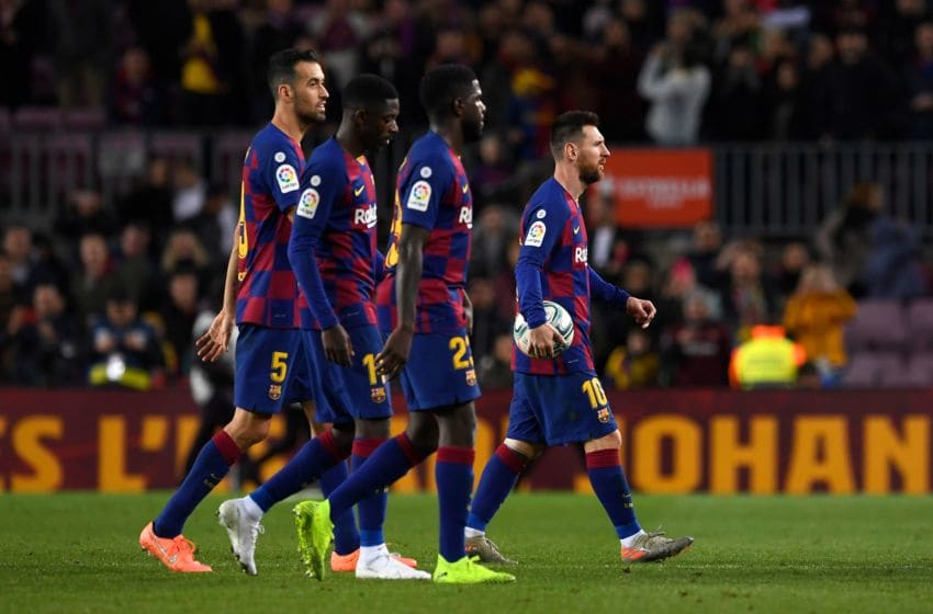 (FromL) Barcelona's Spanish midfielder Sergio Busquets, Barcelona's French forward Ousmane Dembele, Barcelona's French defender Samuel Umtiti and Barcelona's Argentine forward Lionel Messi leave after the Spanish league football match between FC Barcelona and RC Celta de Vigo at the Camp Nou stadium in Barcelona on November 9, 2019. (Photo by Josep LAGO / AFP) (Photo by JOSEP LAGO/AFP via Getty Images)