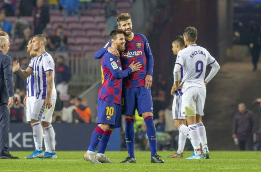 BARCELONA, SPAIN - October 29: Lionel Messi #10 of Barcelona is embraced by Gerard Pique #3 of Barcelona at the end of the game during the Barcelona V Real Valladolid, La Liga regular season match at Estadio Camp Nou on October 29th 2019 in Barcelona, Spain. (Photo by Tim Clayton/Corbis via Getty Images)