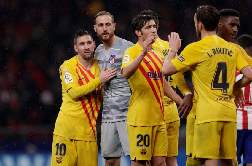 MADRID, SPAIN - DECEMBER 1: (L-R) Lionel Messi of FC Barcelona, Jan Oblak of Atletico Madrid, Sergi Roberto of FC Barcelona, Ivan Rakitic of FC Barcelona during the La Liga Santander match between Atletico Madrid v FC Barcelona at the Estadio Wanda Metropolitano on December 1, 2019 in Madrid Spain (Photo by Rico Brouwer/Soccrates/Getty Images)