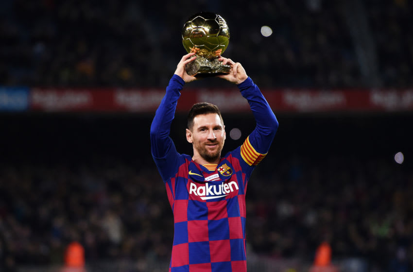 Lionel Messi of FC Barcelona lifts up his sixth Ballon d'Or. (Photo by Alex Caparros/Getty Images)