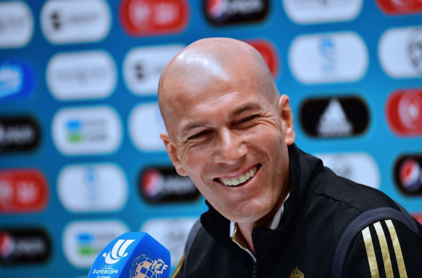 Real Madrid's French coach Zinedine Zidane smiles during a press conference on the eve of the Spanish Super Cup final match, at Saudi Arabia's King Abdullah Sports city stadium in the Red Sea port of Jeddah, on January 11, 2020. (Photo by Giuseppe CACACE / AFP) (Photo by GIUSEPPE CACACE/AFP via Getty Images)