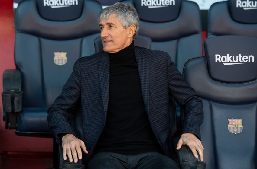BARCELONA, SPAIN - JANUARY 14: Barcelona's new coach Quique Setien poses for the media on the bench during his official presentation at the Camp Nou stadium in Barcelona on January 14, 2020, after signing his new contract with the Catalan club. (Photo by Adria Puig/Anadolu Agency via Getty Images)