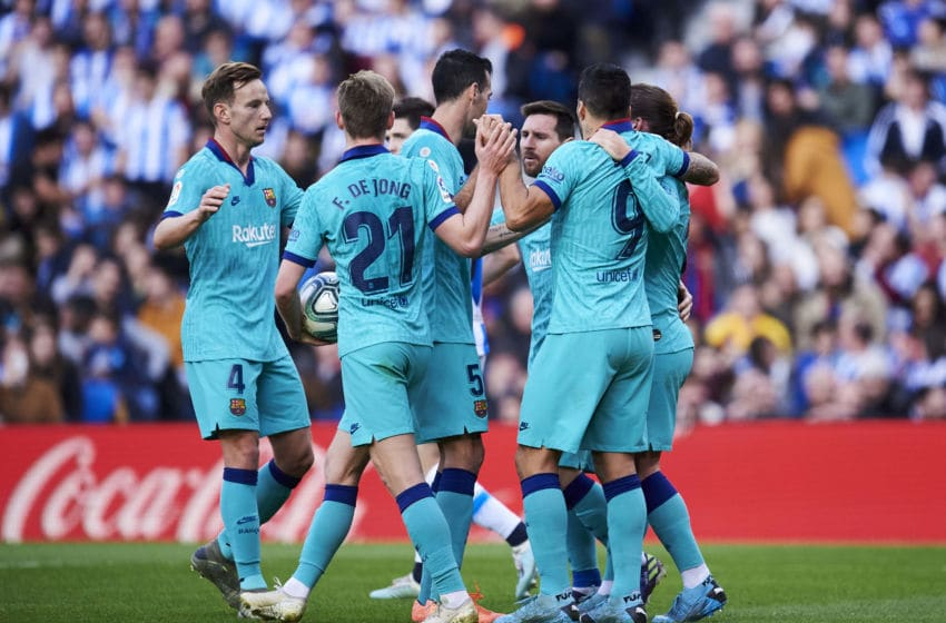 SAN SEBASTIAN, SPAIN - DECEMBER 14: Antoine Griezmann of FC Barcelona celebrates with teammates after scoring the equalizing goal during the Liga match between Real Sociedad and FC Barcelona at Estadio Anoeta on December 14, 2019 in San Sebastian, Spain. (Photo by Juan Manuel Serrano Arce/Getty Images)