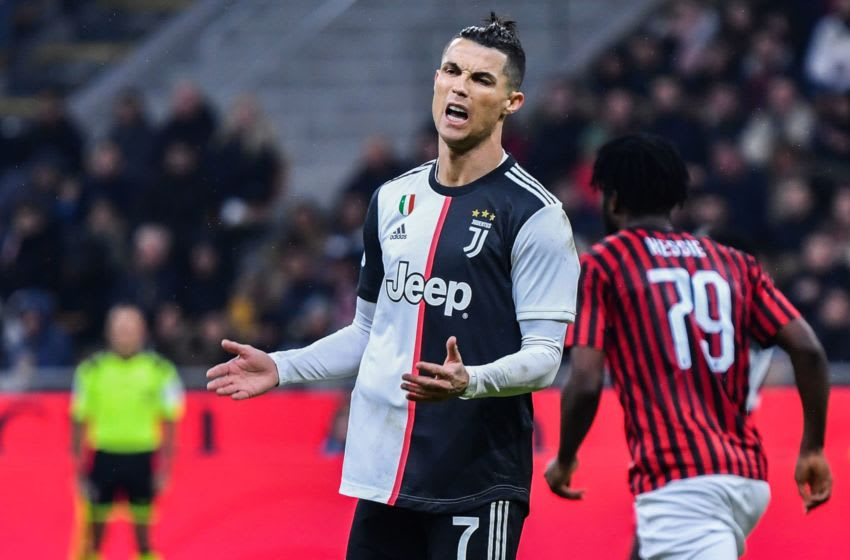 Juventus' Portuguese forward Cristiano Ronaldo reacts during the Italian Cup (Coppa Italia) semi-final first leg football match AC Milan vs Juventus Turin on February 13, 2020 at the San Siro stadium in Milan. (Photo by Alberto PIZZOLI / AFP) (Photo by ALBERTO PIZZOLI/AFP via Getty Images)