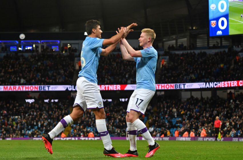 Rodri (L) and Kevin de Bruyne (R), Manchester City (Photo by Anthony Devlin / AFP)