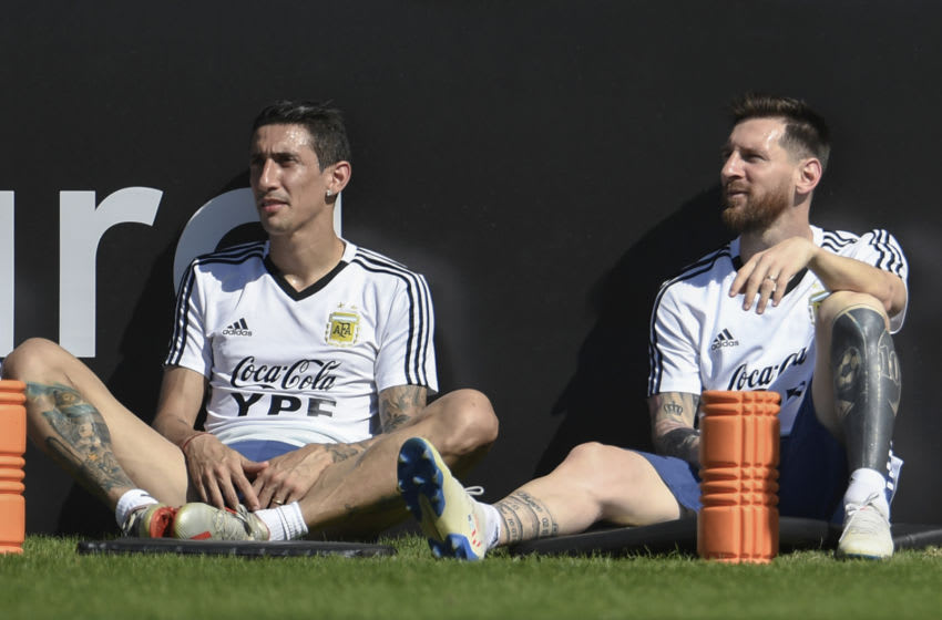 Argentina's players Angel Di Maria (L) and Lionel Messi.(Photo credit MAURO PIMENTEL/AFP via Getty Images)