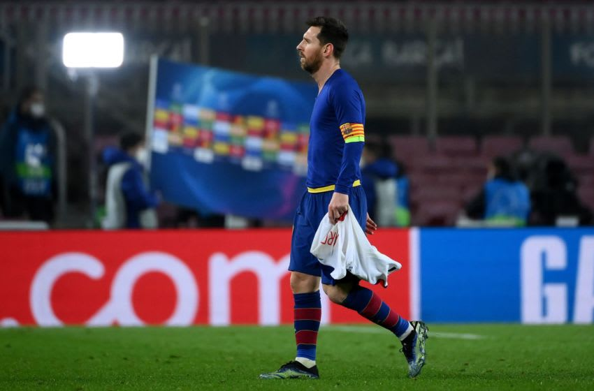 Barcelona's Argentinian forward Lionel Messi walks off the pitch at the end of the UEFA Champions League round of 16 first leg football match between FC Barcelona and Paris Saint-Germain (Photo by LLUIS GENE/AFP via Getty Images)