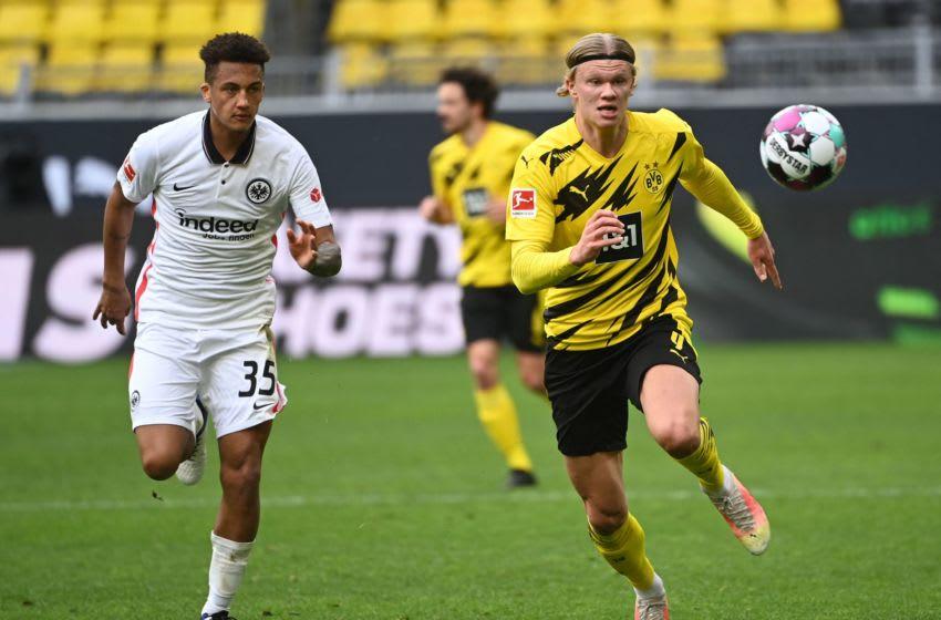 Frankfurt's Brazilian defender Lucas Silva Melo (L) and Dortmund's Norwegian forward Erling Braut Haaland. (Photo by INA FASSBENDER/POOL/AFP via Getty Images)
