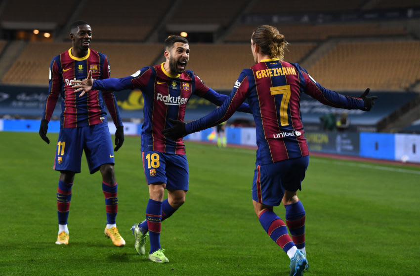 Antoine Griezmann of Barcelona celebrates with team mates (L - R) Ousmane Dembele and Jordi Alba. (Photo by David Ramos/Getty Images)