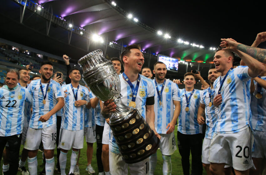 Lionel Messi of Argentina smiles with the trophy as he celebrates with teammates after winning the final of Copa America Brazil 2021. (Photo by Buda Mendes/Getty Images)